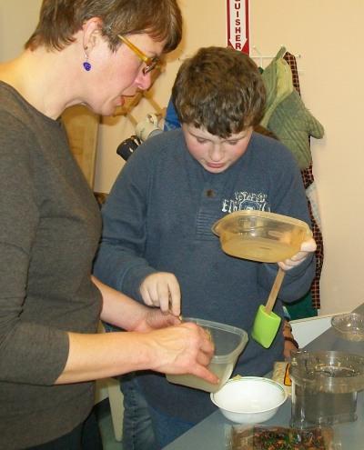 volunteers Lisa helping Seth cook